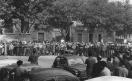Sciopero dei lavoratori della Cge per l'ambiente di lavoro contro la minaccia di licenziamenti - Comizio davanti alla fabbrica - Oratore al microfono - Operai con tuta da lavoro. 5/10/1965